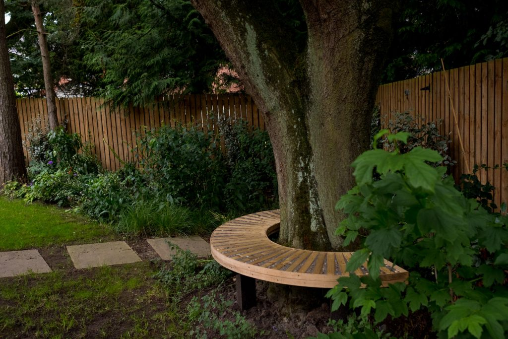 Wooden tree seat. Leeds garden design and build