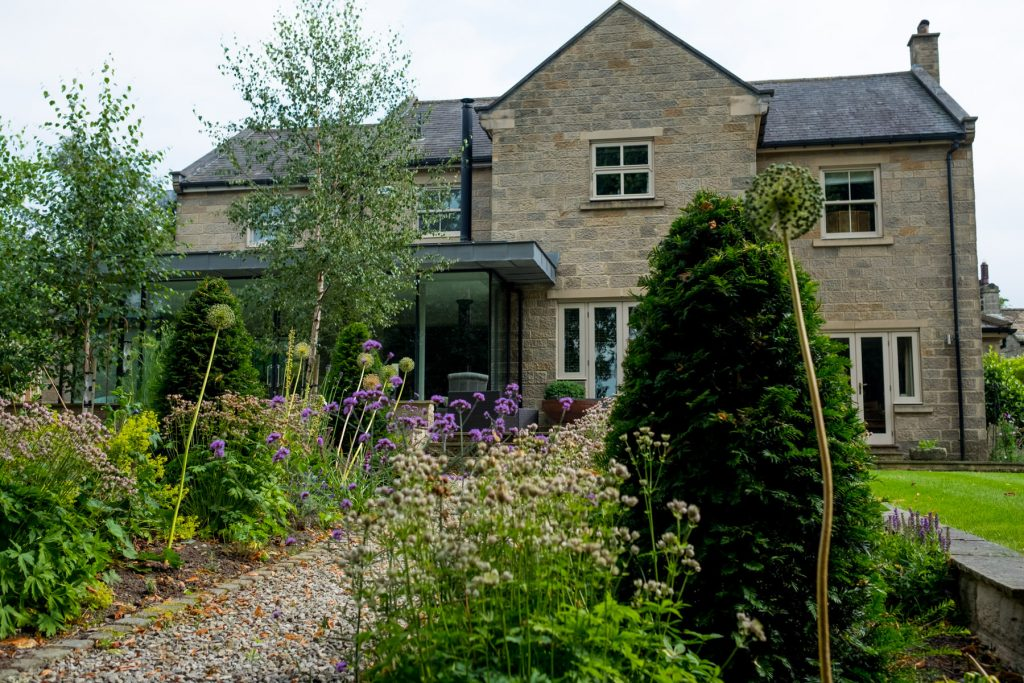 Stone house with herbaceous border. Harrogate Garden DEsign and