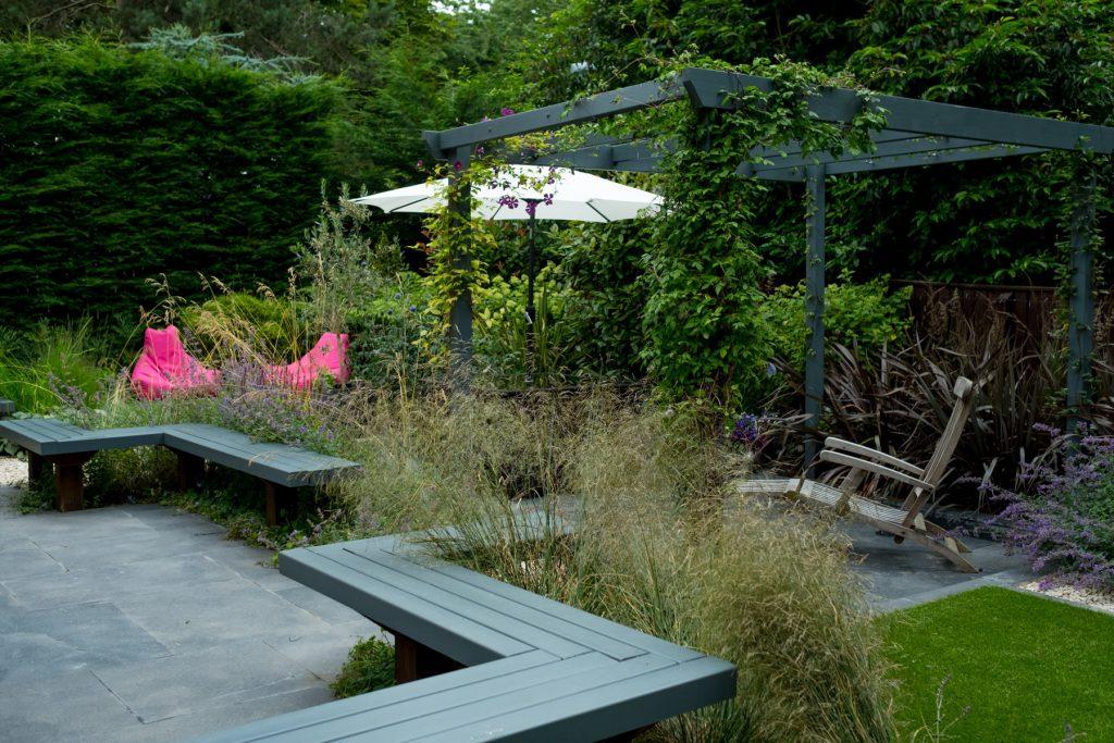 Bright pink lounge beanbag chairs in modern garden. Leeds garden