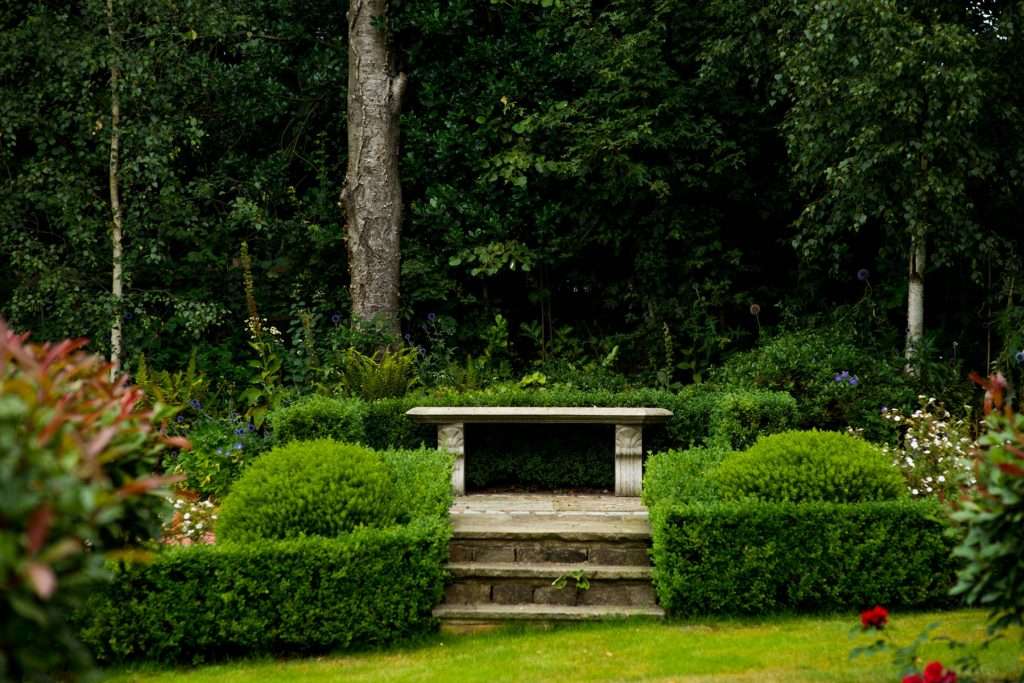 Stone seat with box hedges. Harrogate Garden design and build