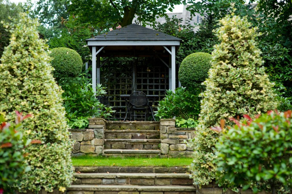 Grey timber pergola and york stone steps. Garden design and buil