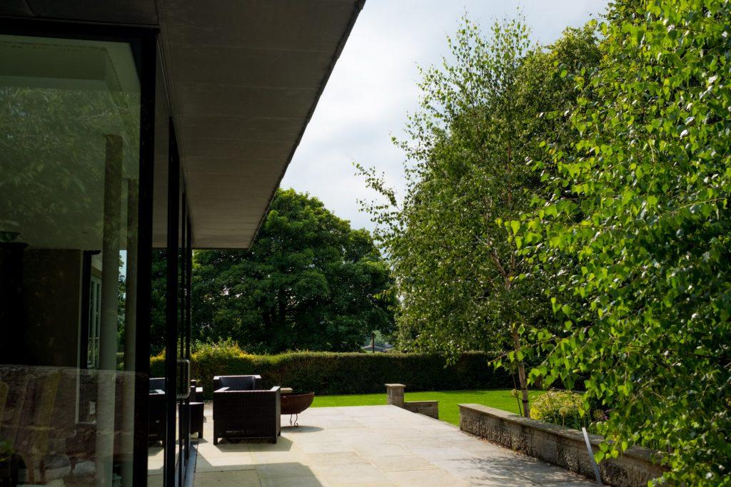 Contemporary extension and patio. Garden DEsign and Build